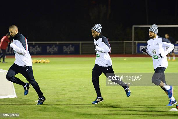 France forward Karim Benzema forward Alexandre Lacazette defender Layvin Kurzawa during a training session at the French national football team...