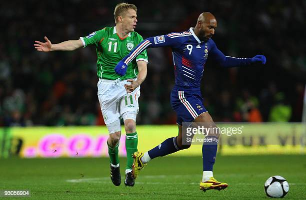 France forward Nicolas Anelka beats Damien Duff to the ball during the FIFA 2010 World Cup Qualifier play off first leg between Republic of Ireland...