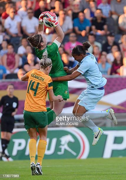 France forward Sandrine Bretigny vies with Australia 's goalkeeper Brianna Davey and defender Alanna Kennedy during the friendly women football match...