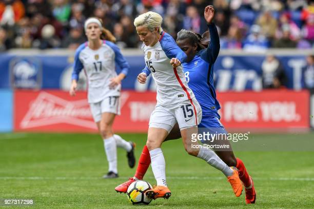 France forward Viviane Asseyi attempts the steal the ball from behind United States of America midfielder Megan Rapinoe in the first half of the...