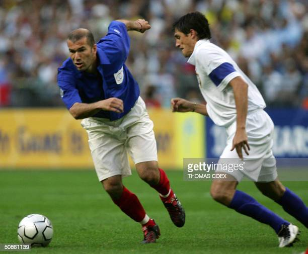 France's midfielder Zinedine Zidane breaks away from Brazil's midfielder Edmilson during the FIFA Centenary football match between France and Brazil...