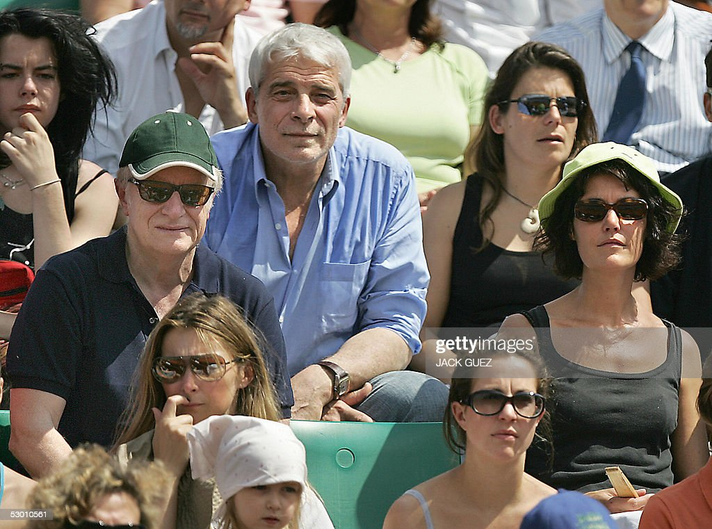 French actor Andre Dussollier (L), comedian Jacques Weber (C), and TV host Caroline Toesca (R) are pictured during a match of the tennis French Open at Roland Garros, 02 June 2005 in Paris.