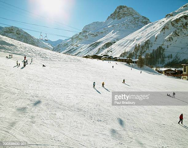 France, French Alps, Val d'Isere, skiers on slope, elevated view