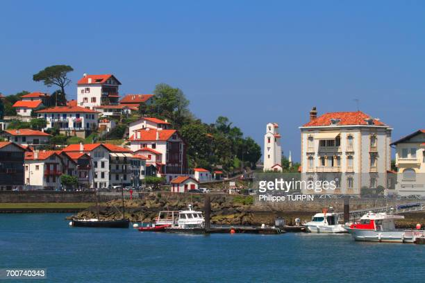France, French Basque Country, Pyrenees-Atlantiques, Saint Jean de Luz, Ciboure in background. Harbours entrance.