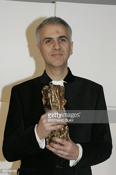French componist Bruno Coulais poses with his Best Film Music Award at the end of the 30th Nuit des Cesar France's top movie awards 26 February 2005...