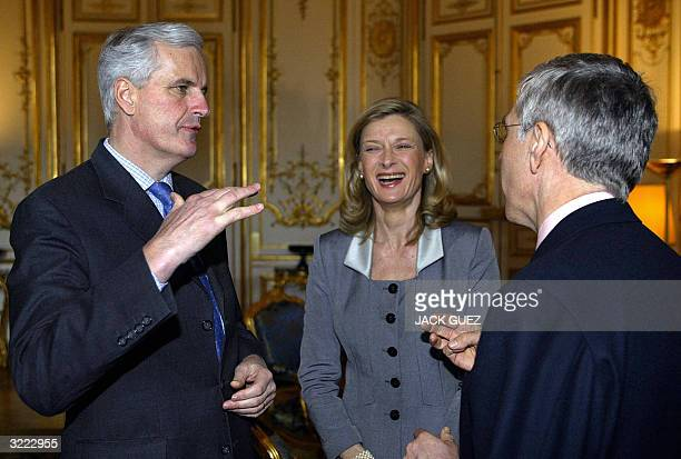 French Foreign Minister Michel Barnier speaks to his British counterpart Jack Straw as Isabelle Barnier laughs before a lunch for Queen Elizabeth II...