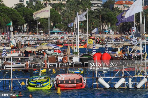 France, French riviera. Cannes. Pier and private beaches.