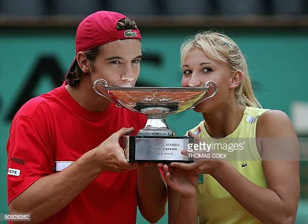 French Tatiana Golovin and Richard Gasquet celebrate with the cup after defeating Zimbabwe's Cara Black and Wayne Black in their mixed doubles final...