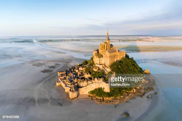 france from the sky : mont saint-michel during the sunrise - モンサンミッシェル ストックフォトと画像