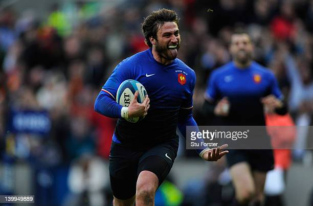 France fullback Maxime Medard runs in his try during the RBS Six Nations match between Scotland and France at Murrayfield Stadium on February 26 2012...