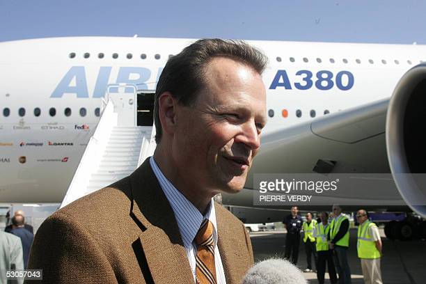 German Airbus A380 pilot Wolfgang Absmeier talks to journalists few minutes after landing at Paris Le Bourget Airport 12 June 2005. The new...