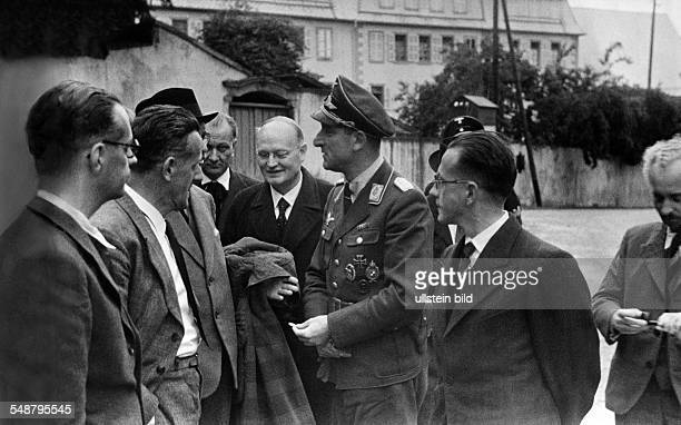2WW france german occupation Alsacians released from french internment camps are officially welcomed after return by the german town major major...