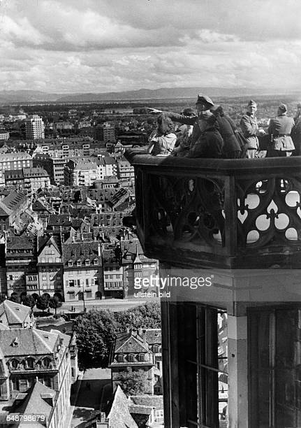 2WW france german occupation German soldiers on the tower of the Strasbourg cathedral looking upon the town July 1940