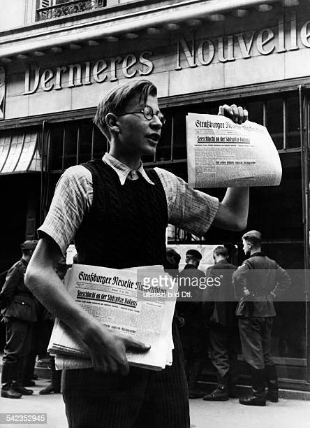 2WW France German occupation Strasbourg Newspaper vendor with the Strassburger Neuesten Nachrichten Photographer Hanns Hubmann
