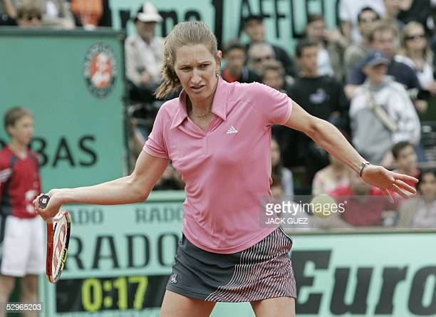 German Steffi Graf returns the ball during the friendly double match Steffi Graf and Belgium Justine HeninHardenne against Russian Marat Safin and...