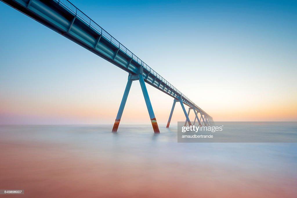 France, Gironde, Arcachon, La Salie, View along elevated walkway leading across sea : Stock Photo