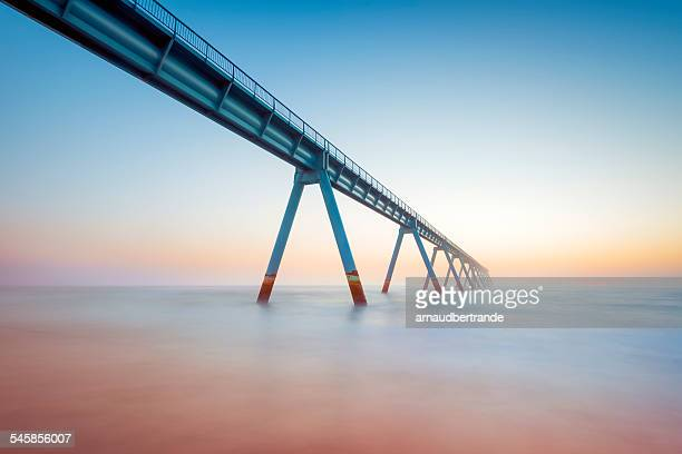 France, Gironde, Arcachon, La Salie, View along elevated walkway leading across sea