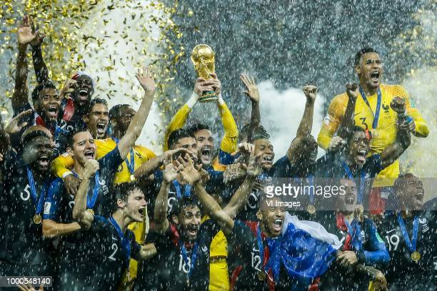 France goalkeeper Hugo Lloris lifts the trophy France goalkeeper Hugo Lloris Benjamin Pavard of France Presnel Kimpembe of France Raphael Varane of...
