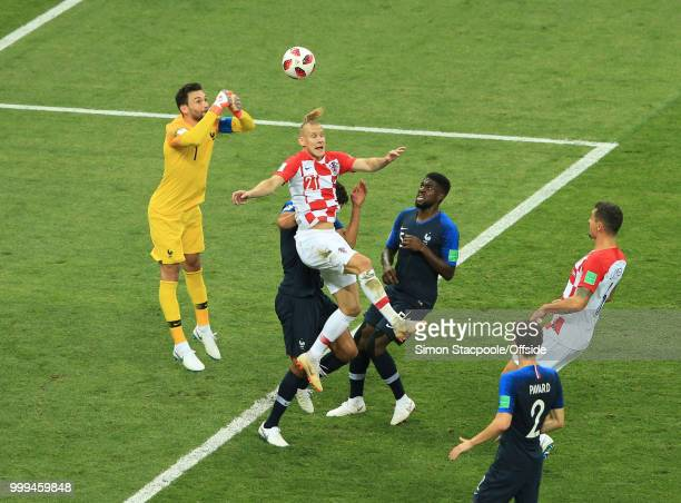 France goalkeeper Hugo Lloris punches clear from Domagoj Vida of Croatia during the 2018 FIFA World Cup Russia Final between France and Croatia at...