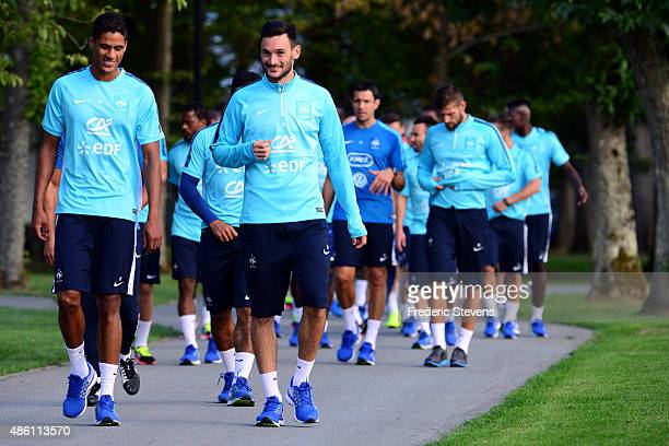 France goalkeepers Hugo Lloris and defender Raphael Varane arrive a training session at the French national football team centre in...