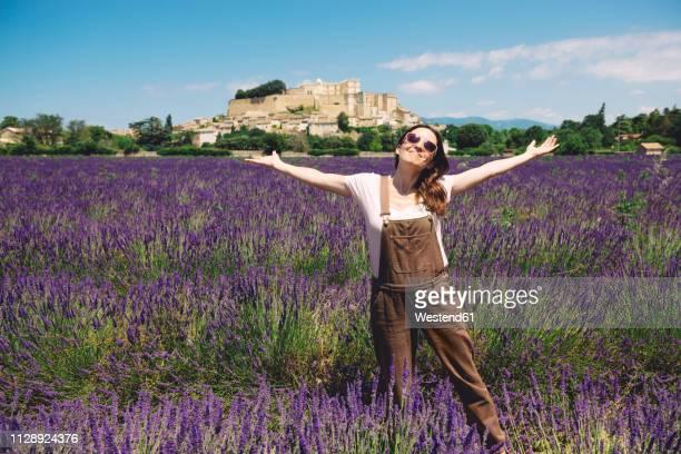 France, Grignan, happy woman standing in lavender field