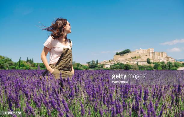 France, Grignan, smiling woman standing in lavender field looking at village