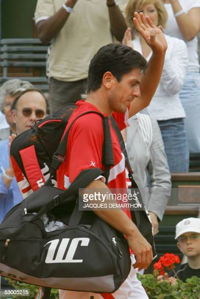 Guillermo Canas of Argentina leaves the court after losing against his compatriot Mariano Puerta during their quarter final match of the tennis...