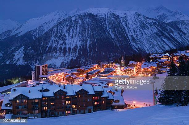 france, haute savoie, courchevel, evening, winter - courchevel stock pictures, royalty-free photos & images