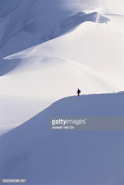 france, haute-savoie, chamonix, mountaineer at aiguille de midi - aiguille de midi stock photos and pictures