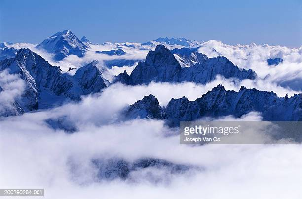 france, haute-savoie, chamonix needles in clouds - vinter os bildbanksfoton och bilder