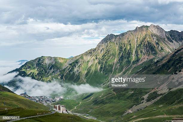 france, hautes-pyrenees, ski resort la mongie and mountain pass col du tourmalet - hautes pyrenees stock pictures, royalty-free photos & images