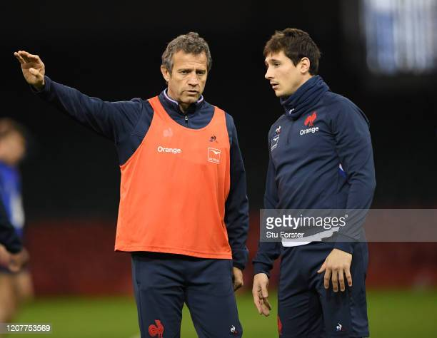 France head coach Fabien Galthie chats with player Baptiste Serin during the France Captains Run ahead of the Guinness Six Nations match against...