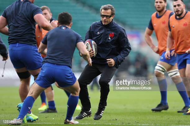 France head coach Fabien Galthie demonstrates a technique ahead of the Guinness Six Nations match between England and France at Twickenham Stadium on...