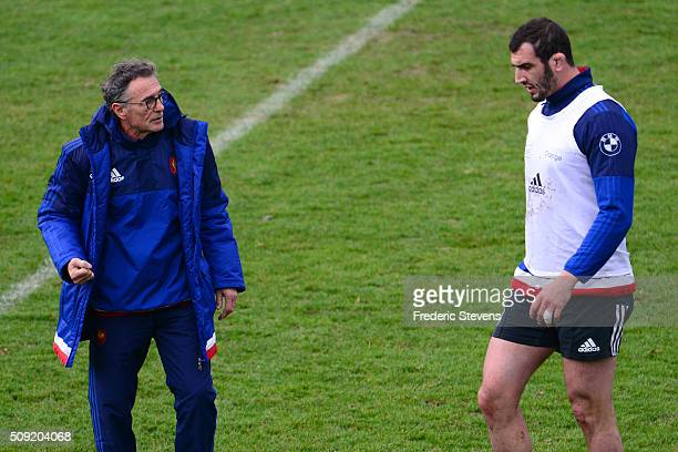 France head coach Guy Noves speak with Yoann Maestri during a training session at National center of rugby ahead of their Six Nations match against...