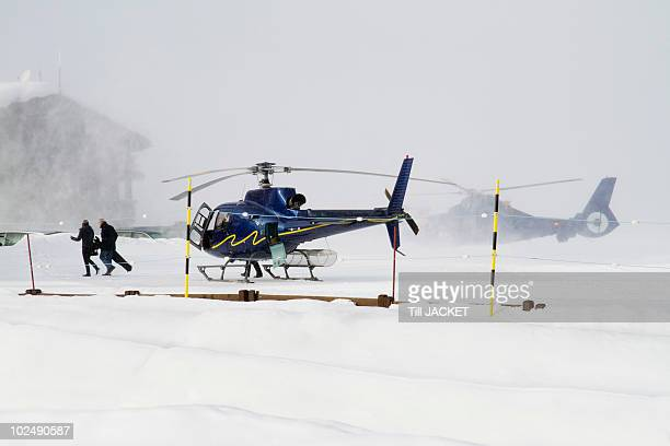 france, helicopters at courchevel heliport - savoie stock pictures, royalty-free photos & images