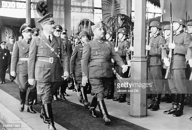 France Hendaye Adolf Hitler and Francisco Franco stepping out the Guard of Honour On the right behind Hitler field marshall Wilhelm Keitel Chief of...
