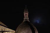 France, Ile de France, Paris, 18th district, Dome of Sacré Coeur basilica with the moon