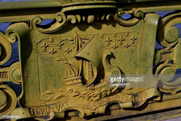 France, Ile de France, Paris (75), Mirabeau Bridge with its sculptures. Emblem of Paris with the ship and the motto of the city: Fluctuat nec mergitur