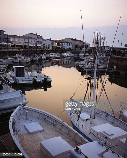 France, Ile de Re, Saint-Martin-de-Re, fishing boats in harbour, dusk