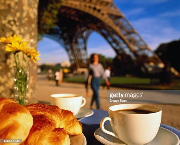france, ile-de-france, paris, coffee and croissants on table - paris france stock-fotos und bilder