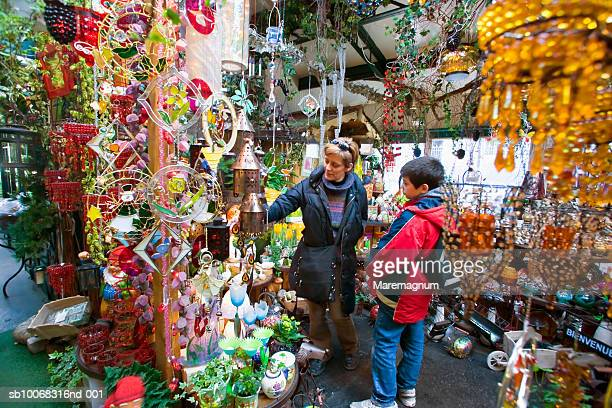 France, Ile-de-France, Paris, Ile de la Cite, mother and son (10-11) at Flower Market