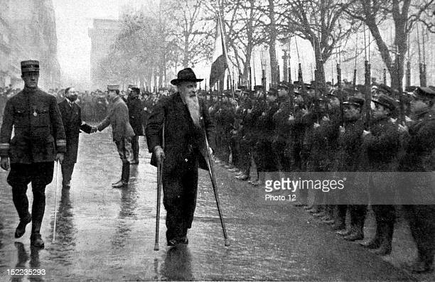 France In Paris a military review on the ChampsElysees General Ricciotti Garibaldi the son of Garibaldi and his own son pass the troops in review
