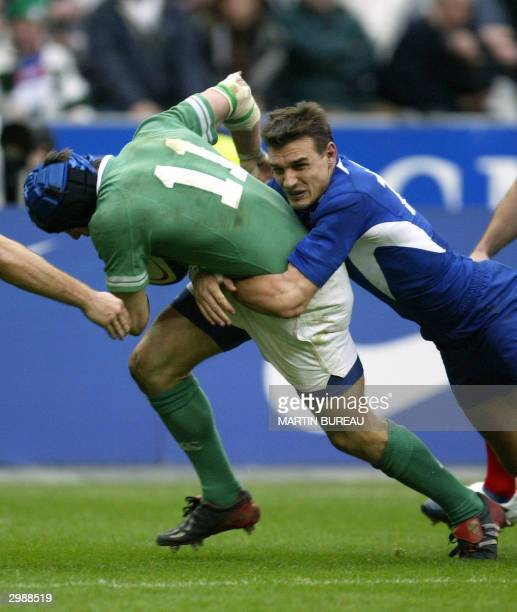 Irish winger Tyrone Howe is tackled by French fullback Nicolas Brusque during the Six Nations rugby union match between France and Ireland 14...