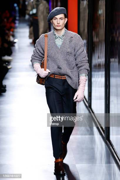 A model walks the runway during the Dior Homme Menswear Fall/Winter 20202021 show as part of Paris Fashion Week at Place de la Concorde on January 17...