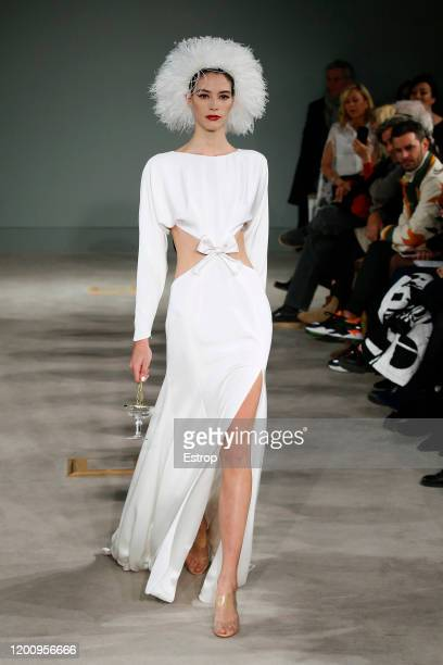 A model walks the runway during the Alexis Mabille Haute Couture Spring/Summer 2020 show as part of Paris Fashion Week on January 21 2020 in Paris...