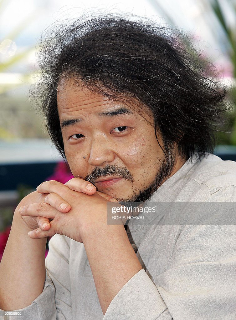 Japanese director Mamoru Oshii poses during a photo call for his film 'Innocence', 20 May 2004, at the 57th Cannes Film Festival in the French Riviera town. The film is in competition for the festival's top prize, the Palme d'Or.