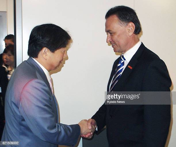 PARIS France Japanese farm minister Yoshimasa Hayashi and Australian trade minister Craig Emerson shake hands in Paris France on May 30 2013 Free...