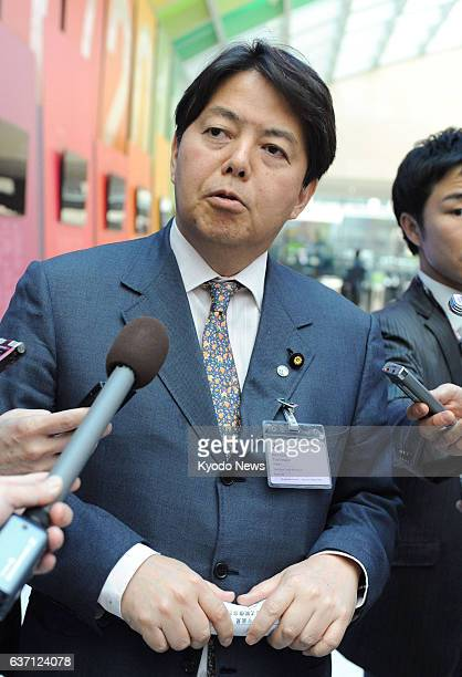 PARIS France Japanese farm minister Yoshimasa Hayashi speaks with reporters in Paris on May 7 2014 Hayashi attended an informal ministerial meeting...