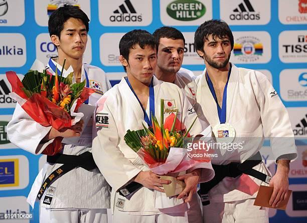France - Japan's Naohisa Takato stands on the podium after winning the men's 60-kilogram final against South Korea's Jang Jin Min at the Paris Grand...