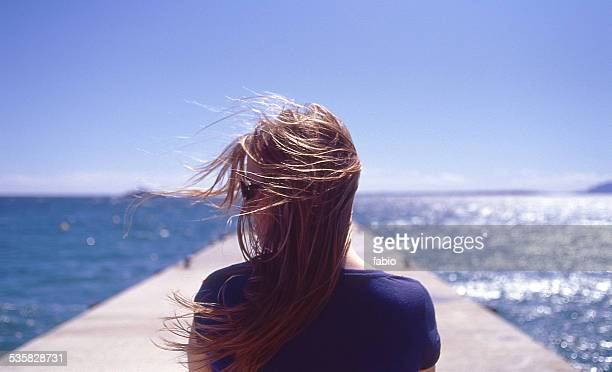 France, Juan les Pins, Rear view of woman with wind blowing